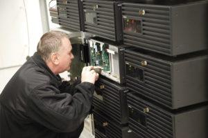 Man making repairs to server
