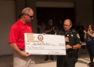 Wagner Receives Check for PAL from Hodges