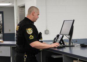 sheriff at computer