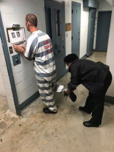 sheriff interacting with jail resident