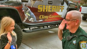 sheriff and kid high fiving