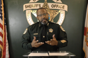 Sheriff Darryl Daniels at a podium with the CCSO logo in the background