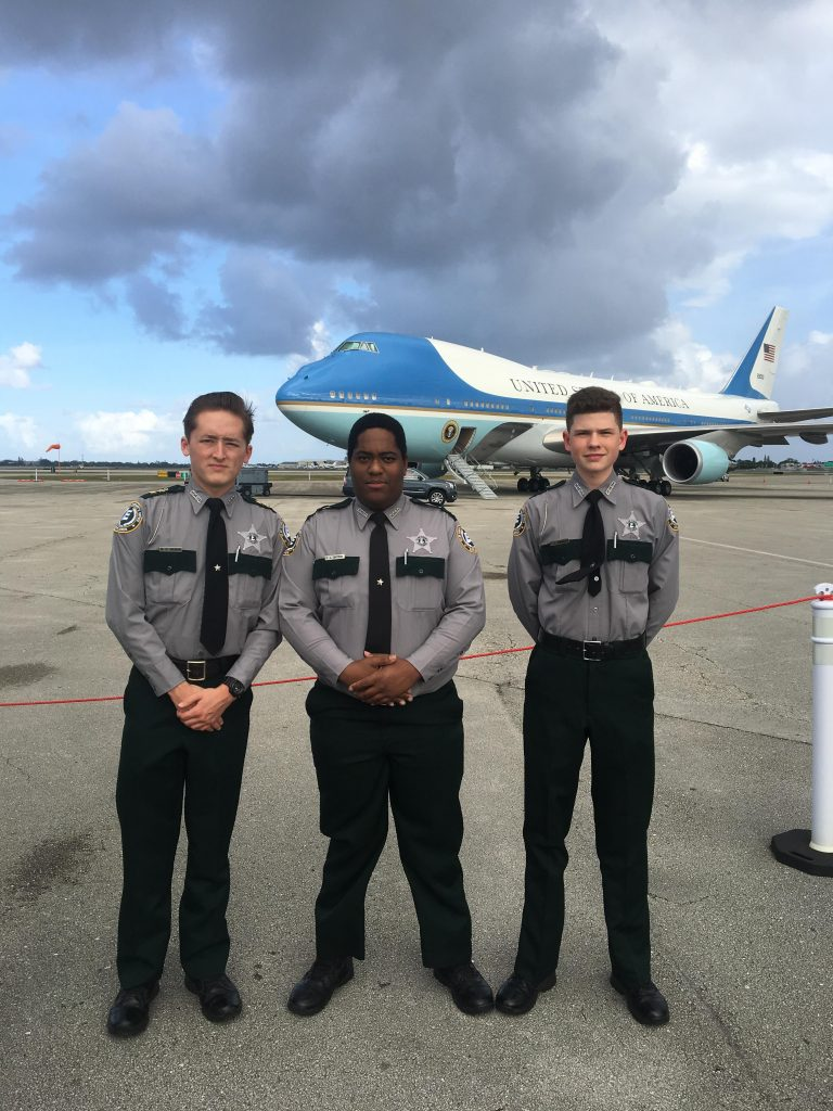 Members of the CCSO Explorer program stand in front of Air Force One.