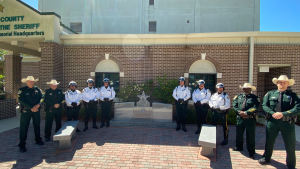 Officers in front of memorial