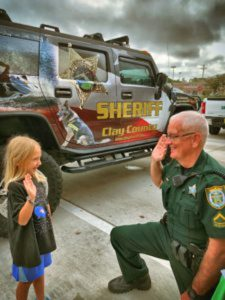sheriff and kid facing each other