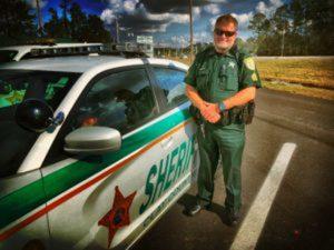 sheriff next ot police car