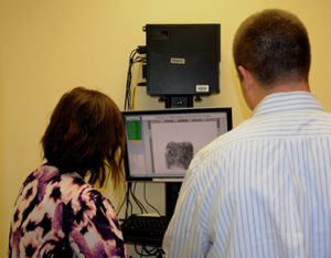 person getting finger print scanned