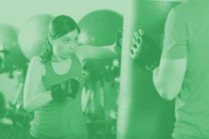 woman punching exercise bag
