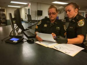 sheriffs reading documents