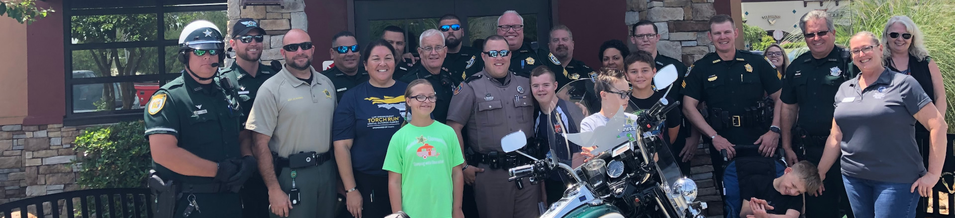 children special needs posing with Sheriffs