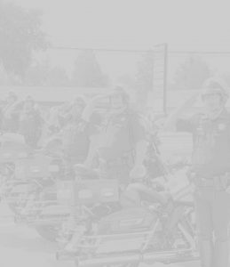 officers in a line saluting next to motorcycles