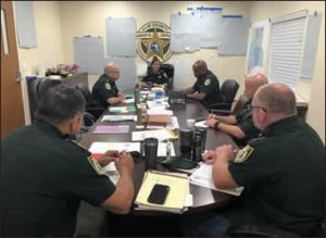 Sheriffs sitting at a table