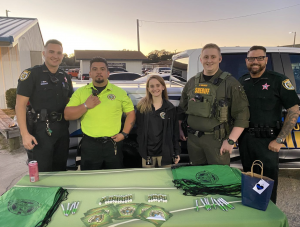 CCSO members stand behind a table at a recruiting event