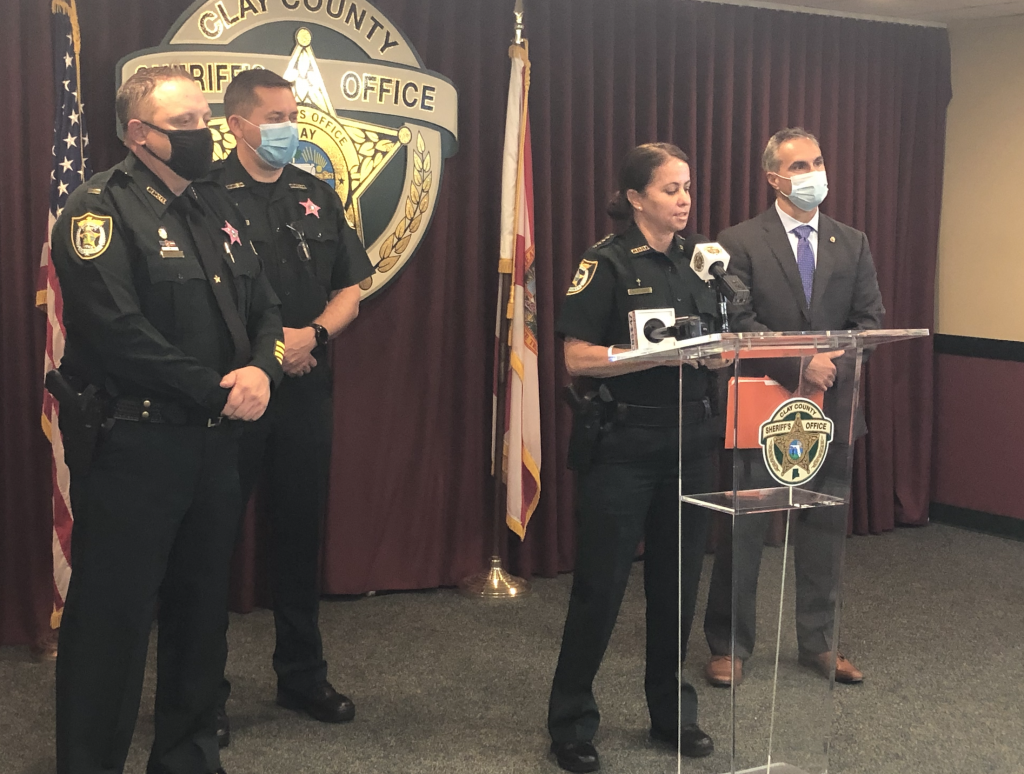 Sheriff Michelle Cook at a news conference with other CCSO members
