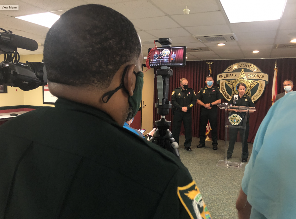 Deputy Ford recording a news conference with his phone