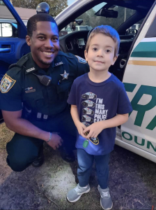 CCSO deputy with a young boy