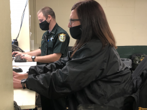 Deputies working in the booking room