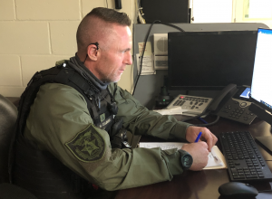 Picture of uniformed detention deputy at work