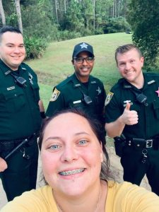 Three CCSO deputies and a woman smiling taking a selfie