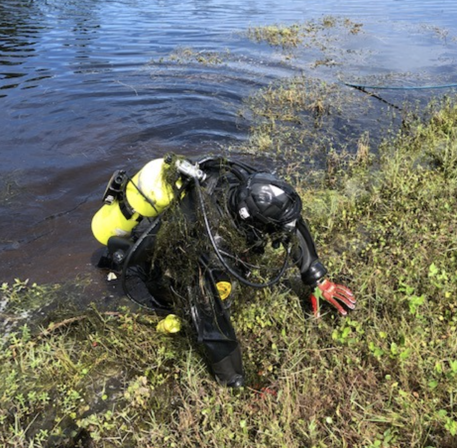 Dive team member in gear getting out of water