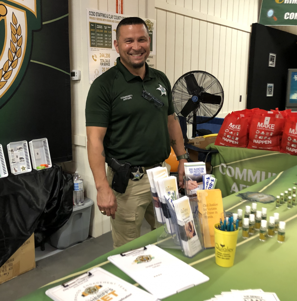 Deputy Bryon Maylon stands behind the CCSO booth at the Clay County Fair