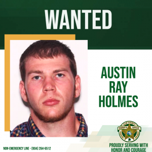 A wanted poster of fugitive Austin Ray Holmes