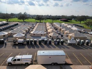 Trucks, tents, and vehicles are lined up in response to Hurricane Ida